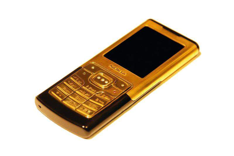 MJ - Gold Nokia 6500. Super Slim Luxury Mobile Phone. Case & Buttons from Solid Gold inlaid Diamonds, Emerald & Ruby.