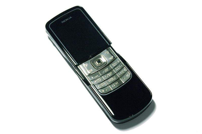 MJ - Nokia 8600 Luna White Gold. Inlaid Diamonds & Dark Blue Sapphire.